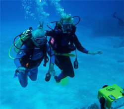 Dive Buddies. Mother and daughter. Age 82 and 65! Mom sta... by Paul Holota 